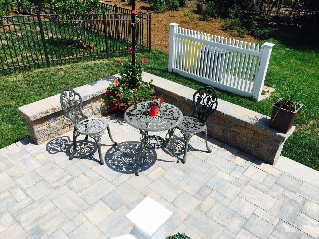 Aerial view of stone patio and wall with table