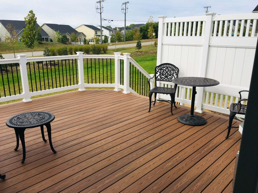 composite trex brown wood deck with dining furniture