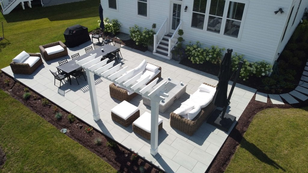 Custom backyard patio with pergola and outdoor furniture