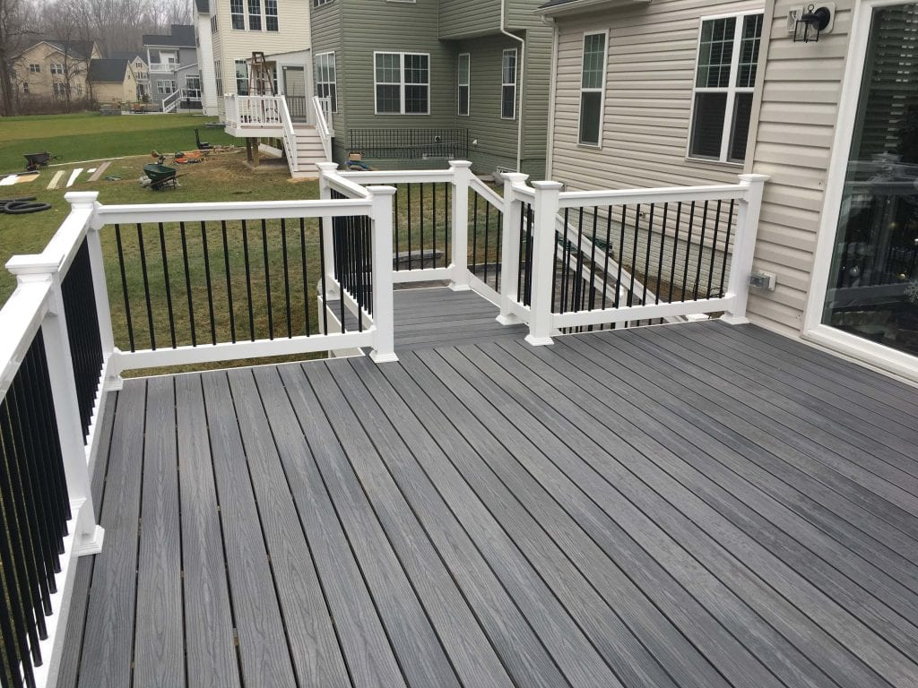 composite trex wood deck with stairway to ground