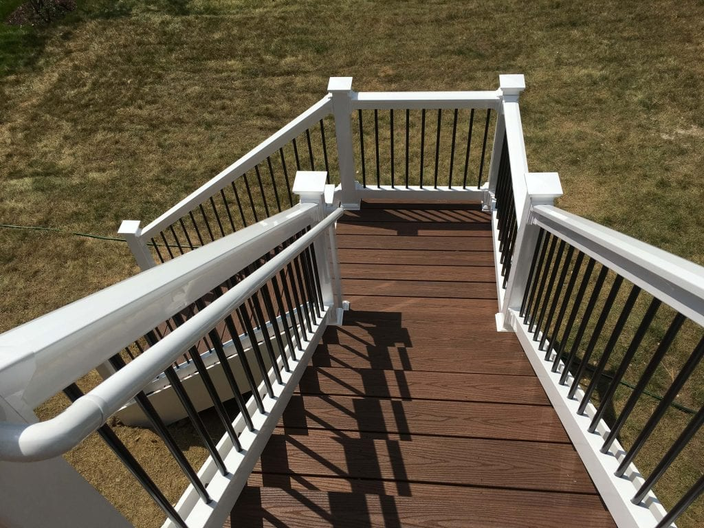 Brown composite deckboards on stairway to ground