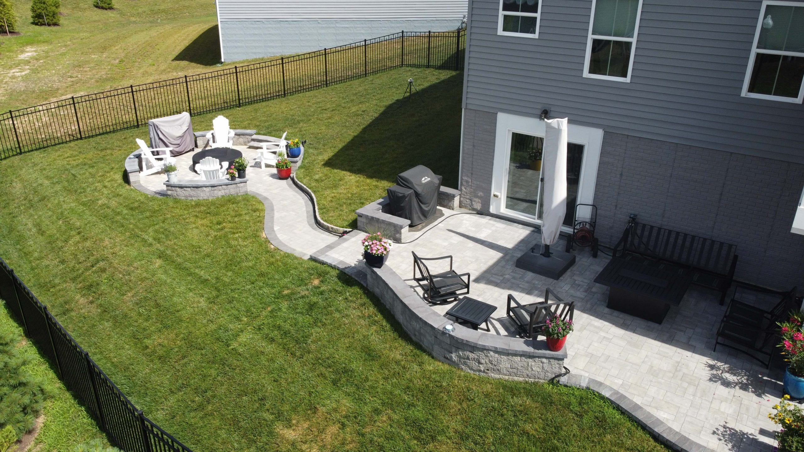 New construction - expansive patios, walkways and fire pits constructed in back yard