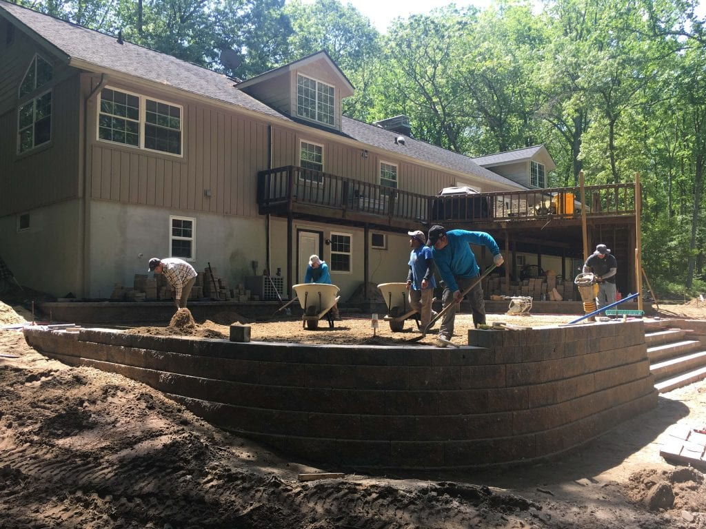 Patio retaining wall under construction at single family home