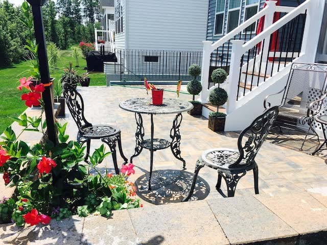 natural stone paver patio with dining furniture