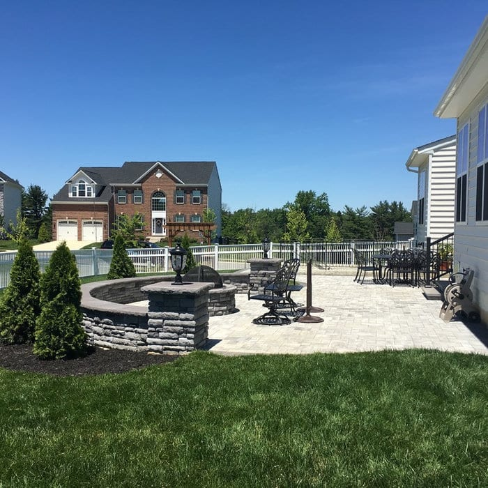 Magness Development - patio with fire pit and wall in Bel Air, MD