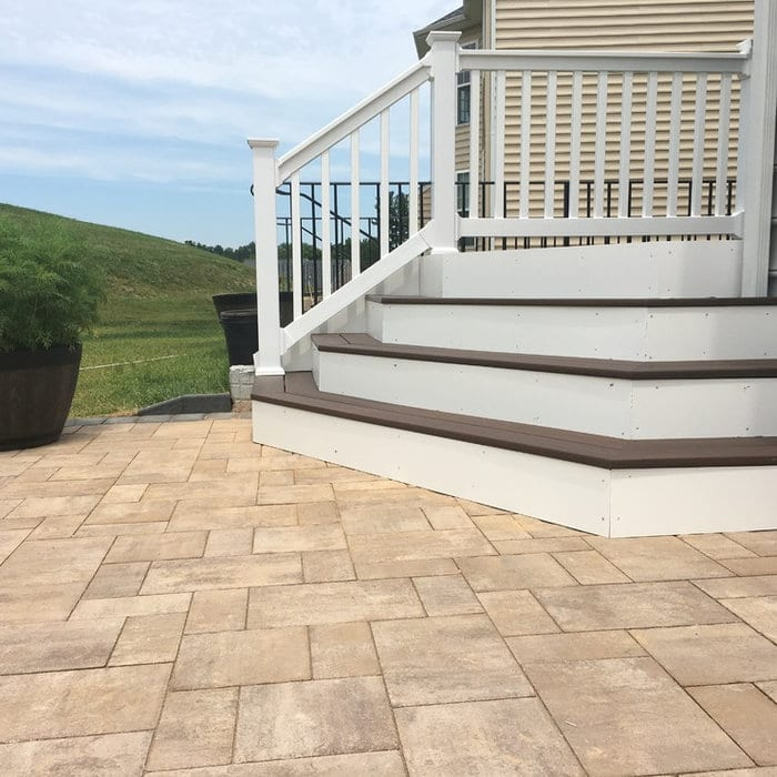 Paver patio with composite stairs up to back door in Ellicott City, MD