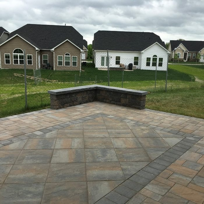 Natural stone paver patio - brown and gray with corner wall in Two Rivers Development
