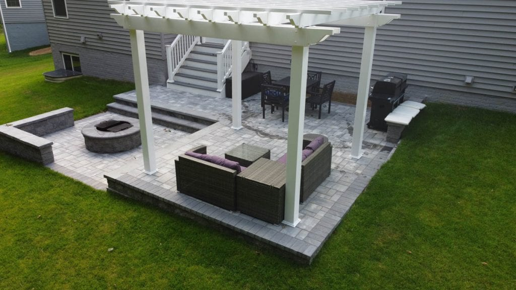 Pergola and outdoor seating, fire pit on paver patio