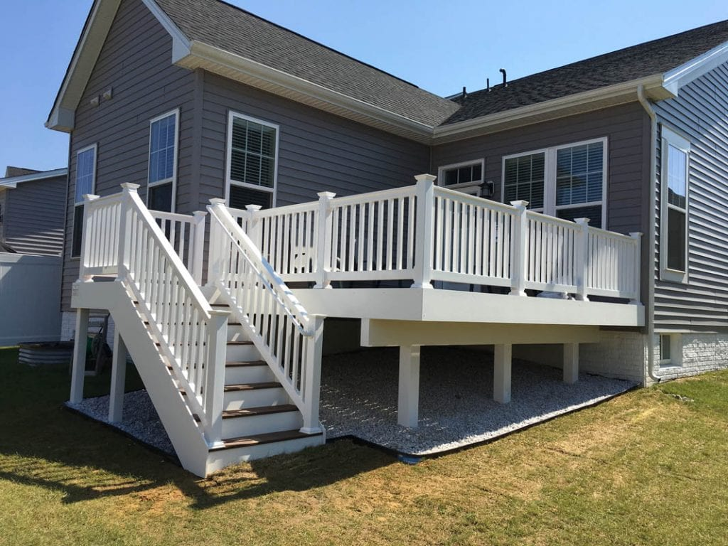 White single story composite deck built on rear of home
