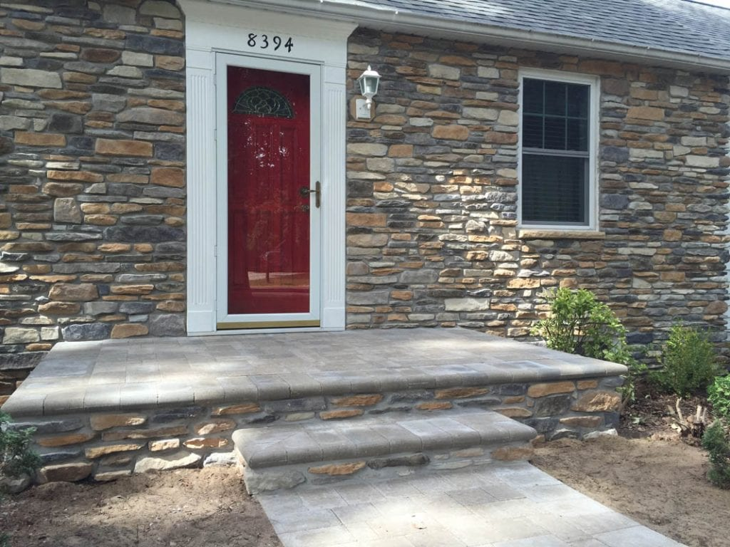 Stone veneer on front of home exterior wall