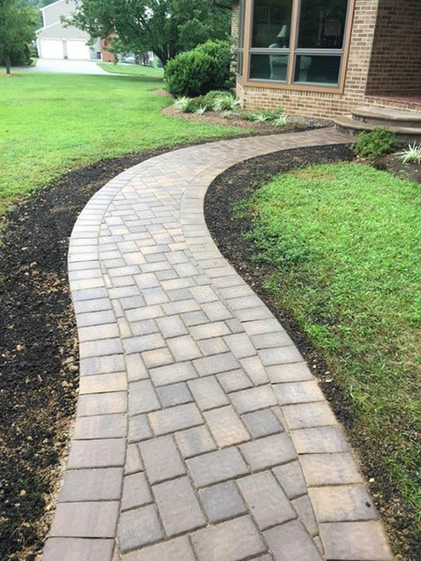 Glossy finish, wet look paver sidewalk s-shape leading to home