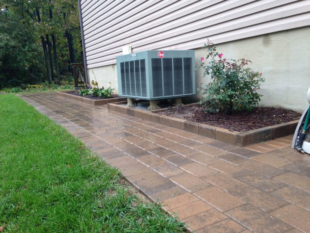Wet look, glossy finish paver sidewalk leading from front yard to the back yard