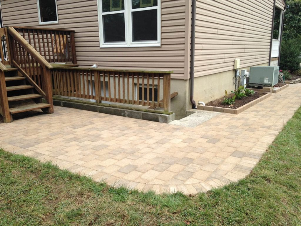 Paver sidewalk leading from front yard to the back deck